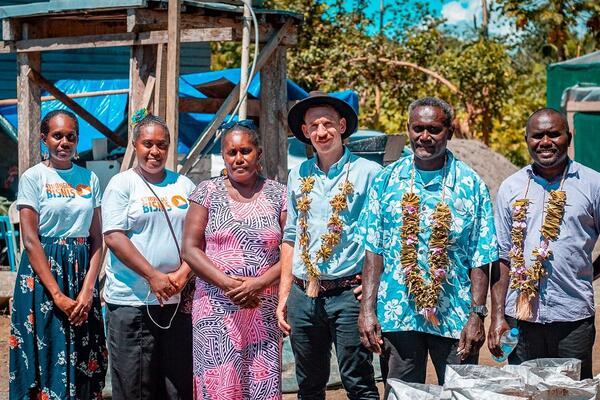 Strongim Bisnis staff with Prosperity Farm Supplies team members on a farm tour.
