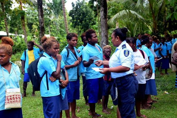 Local RSIPF officer shares the NGE pamphlets with students who attended one of the awareness programs.