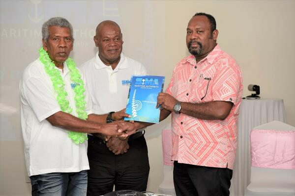 (L-R) Chairman of the SIMA board, Robert Bokelema, a staff from SIMA and MID Deputy Secretary, Jimmy Nuake with the newly launched corporate plan document