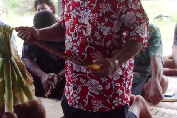 A representative and spokesperson for Solomon Islands students presenting traditional gifts to the Fijian family during the ceremony on Sunday 14th April.