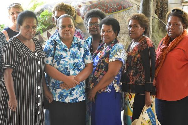 Two women candidates Pauline Radoe, second from left, and Rose Anilabata, right, with their campaign managers and workshop facilitators at the Honiara Hotel on Tuesday.