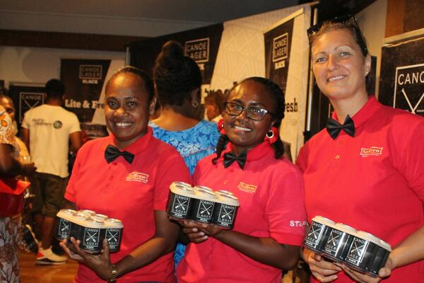 SolBrew staff (l-r) Serah Baulo, Brew Manager, Naomi Kalamani, QC Manager and Polona Berlec, Logistics Manager with Canoe Black 6 packs for guests.