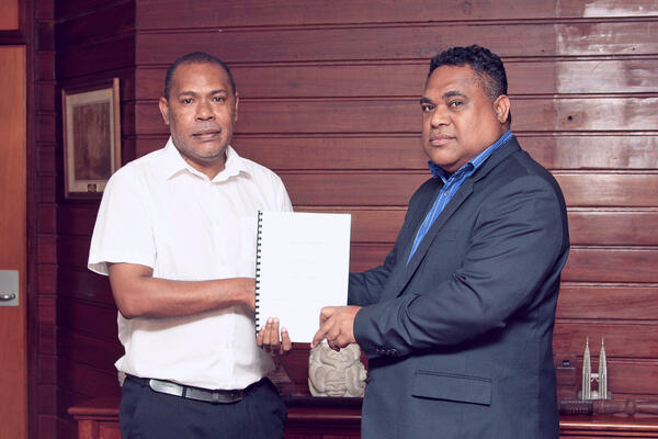 Smiley Giobauta, IFC's country officer for Solomon Islands and Dr Luke Forau, Central Bank Governor, after the signing.