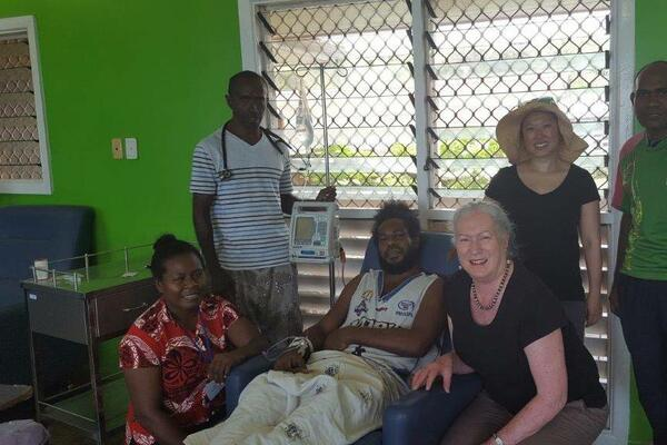 The team treating the 34-year-old patient at the hospital in Honiara, Solomon Islands. From left: nurse Meltus, Dr Andrew Soma, the patient, Wendy Spencer, Beth Hua and nurse Stephen.