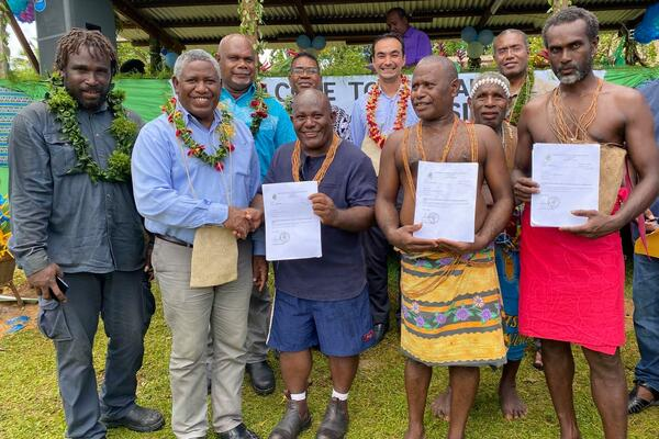 Honorable Minister for Lands, Housing and Survey (MLHS), Ishmael Avui, congratulates three landholding groups, including the Rarirahuta, Paehusi and Huniharu of East Are' Are, for receiving their certificates of completion of the Customary Land Recording process under the Customary Land Recording Act.