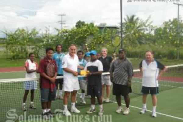 Australian High Commissioner, Frank Ingruber, handing over the cheque to SI Tennis Federation's David Wingston.