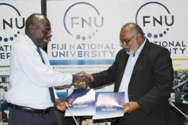SINU Vice Chacellor Dr Glynn Galo shakes hand with FNU Vice Chacellor Dr Ganesh Chand.