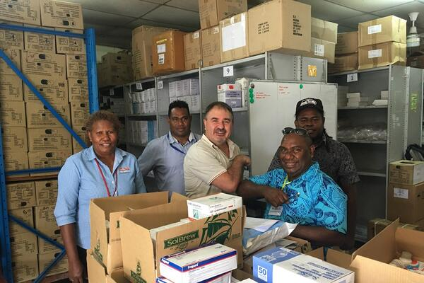 SolBrew handover Medicine to NRH Pharmacy - Dr John Hue, Medical Superintendent and Supervising CEO NRH with Peralt van der Merwe SolBrew MD (centre) looked on by Grace Campbell (far left) and Acting Chief Pharmacist Solomon Bosa (back right).