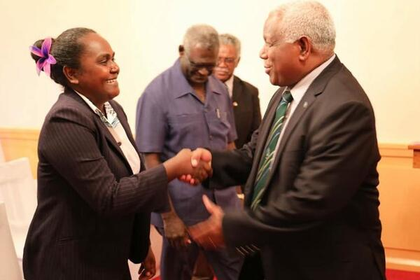 Solomon Islands' new Minister for Women, Youths, Children and Family Affairs, Lanelle Tanangada, shakes hands with prime minister Rick Hou after her swearing in ceremony at Government House in Honiara.