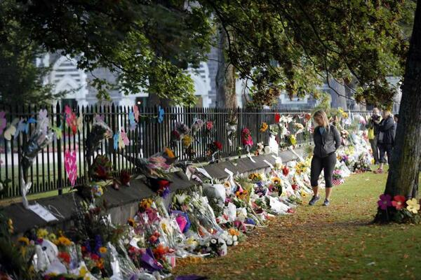 Mourners paying their respects at a makeshift memorial at the Botanical Gardens in Christchurch, New Zealand, Saturday, March 16, 2019.