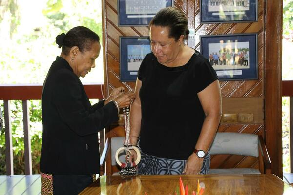 Papua New Guinea's High Commissioner to Fiji, H.E Ms. Lucy B. Bogari (L) presents her credentials to Dame Meg Taylor, the Secretary General of the Pacific Islands Forum.