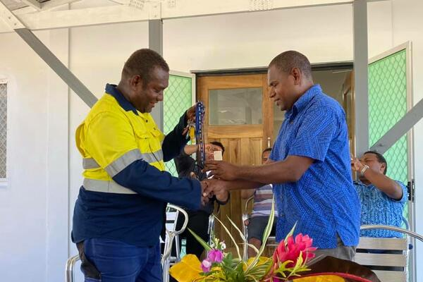Mr Ricky George hands over keys to Mr Patterson Lusi of MFMR.