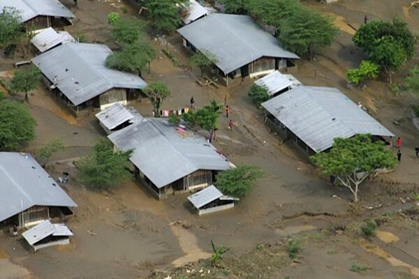 Homes are surrounded by mud and flood waters on the Guadalcanal Plains, Solomon Islands.