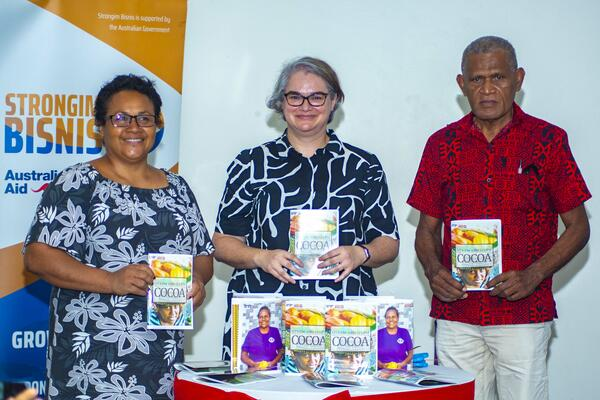 "Launching the book ""Mekim and Selem Cocoa"". (L to R): Permanent Secretary for the Ministry of Agriculture and Livestock, Ethel Frances; Deputy Australian High Commissioner to Solomon Islands, Sally-Anne Vincent; and Director of Solomon Islands Association of Rural Training Centres, Billy Mae."