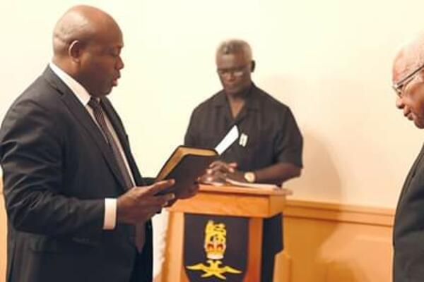 New Minister for Police, National Security and Correctional Services Anthony Veke sworn-in before the Governor General.