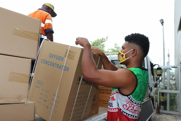 Oxygen concentrators are unloaded in April at Jacksons airport, Port Moresby, PNG.