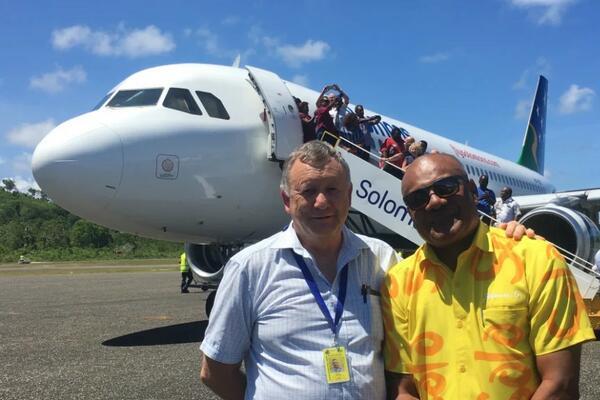 Solomon Airlines Chief Executive Brett Gebers (L) and Tourism Solomons Chief Executive Josefa Tuamoto (R) on the tarmac in Munda.