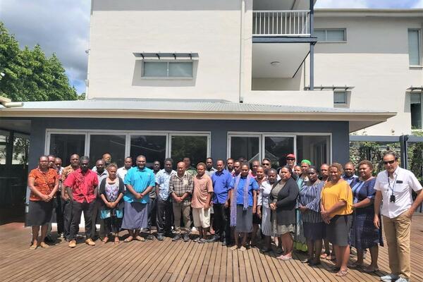 Group photo of NHEOC IC Dr Nemia Bainivalu, training facilitators including MHMS Advisor Dr Yogesh Choudhri and participants.