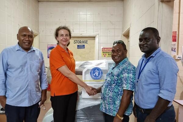 Handing over of X-ray machine by WHO OIC Dr Sonja Tanevska (centre left) to NRH Medical Superintendent, Dr John Hue.