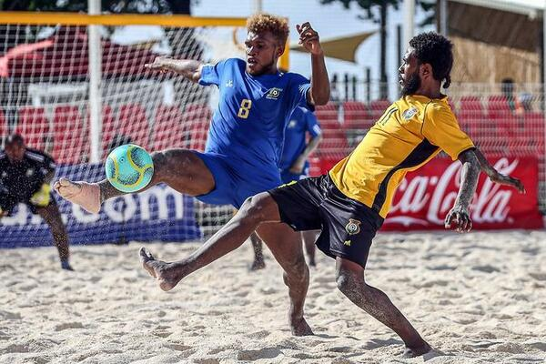 Solomon Islands Anthony Talo gets a foot to the ball ahead of Vanuatu's Loic Boulet.