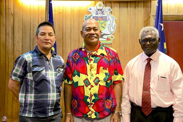 Chairman of Caucus Namson Tran, MP for MOI Martin Kealoe and Prime Minister Sogavare.