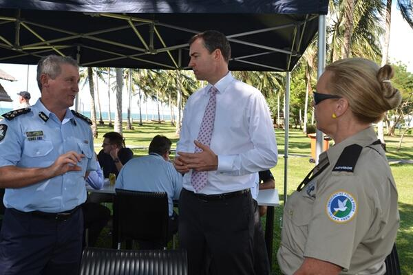 Australia's Justice Minister Keenan (c) speaking with Commander of the Participating Police Force, Greg Harrigan.