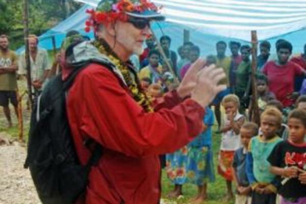 Sir Richard addressing the village at Mbimba on Lord Howe Island and explaining about malaria elimination.