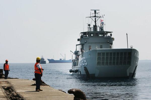 HMAS Tarakan, followed by HMAS Labuan, prepares to berth in Honiara, Solomon Islands for Operation Render Safe 2013.