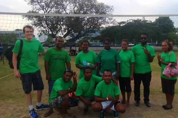 "The PSO ""Green Hornets"" volleyball team after a hard fought victory. From left to right, back row: Clancy Dane, Daniel Kwalai, Tina Haro, Kathleen Kohata, Ethel Ratu, Lazarus Waroka, Martha Manaka. Front: Wesley Ramo, Peter Herehura, Leonard Chite."