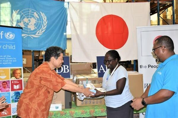 His Excellency Morimoto Yasuhiro, Japanese Ambassador to Solomon Islands handing over some of the Japanese funded PPEs to the Permanent Secretary of the Ministy of Health Mrs. Pauline McNeil, in front of Dr. Zelalem Taffesse, Chief of UNICEF Solomon Islands Field Office.