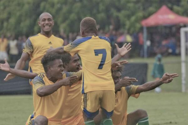 Isabel Frigate players celebrate a late come back to defeat Honiara Warriors.