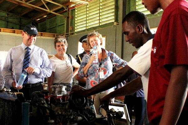 A mechanics student provides a demonstration to AusAID Director General Peter Baxter.