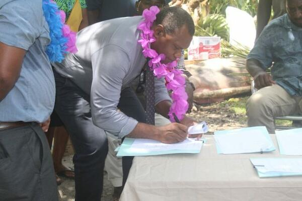 Acting Permanent Secretary Mr Ferral Lasi signing the MOU to develop Aruligo into a national aquaculture centre.