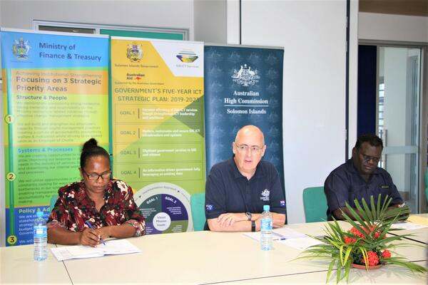 The Australian High Commissioner, His Excellency Dr. Lachlan Strahan (center), Permanent Secretary McKinnie P Dentana (right) and the Deputy Secretary Margaret Moveni (left) participated in the SIG ICT Services launch at the SIG ICT Office.