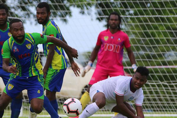 Players scramble for the ball during the Lae City vs Henderson Eels clash in Group B of the OFC Champions League in Luganville on Saturday.