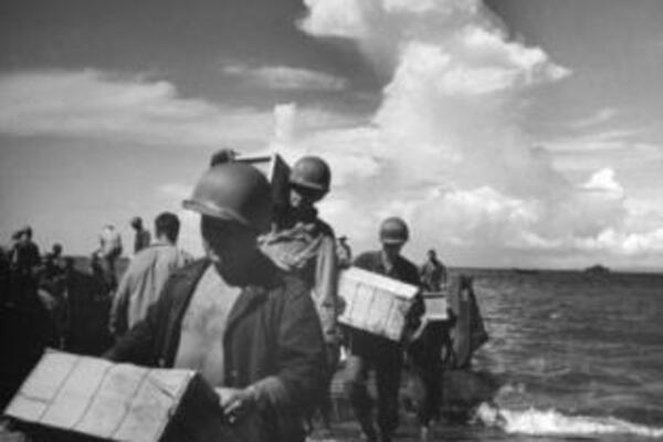 The U.S. Army lands troops and supplies on Guadalcanal in 1942.