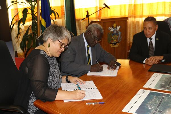 Hon. Prime Minister and the New Zealand High Commissioner at the signing ceremony, witnessed by the Minister for Aviation, Hon. Shanel.
