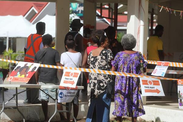 Voters in Central Honiara casting their ballot yesterday.