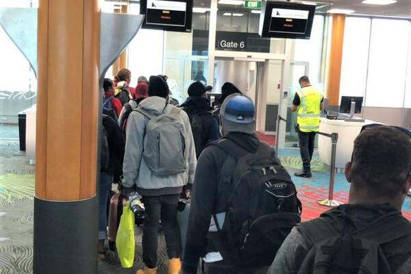 Solomon Islanders boarding Solomon Airlines at the Auckland International Airport.