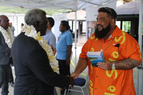 Prime Minister Manasseh Sogavare being greeted by a Tourism Solomons staff at the launching of the campaign.