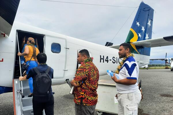 Passengers boarding the VIP scenic flight prior to pilot briefing and take off at Henderson Airport.