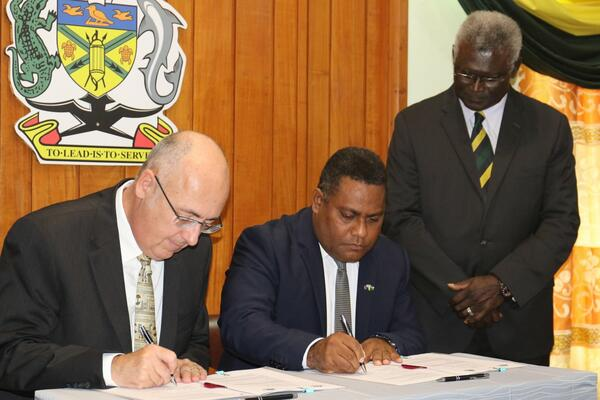 The signing took place at the Office of the Prime Minister & Cabinet (OPMC) by the Minister of Planning and Development Coordination, Hon Rexon Ramofafia and the Australian High Commissioner, His Excellency Dr Lachlan Strahan.