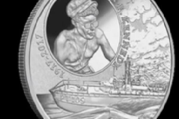 The design of this wonderful coin pays tribute to the act of endurance, heroism and leadership shown by Lieutenant John F. Kennedy in 1943 during WWII in the Pacific, specifically the Solomon Islands.