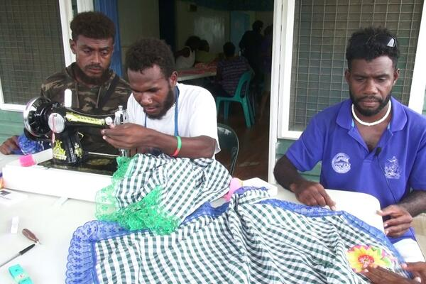Henry, Rex and Patterson at the sewing class facilitated by the Guadalcanal Provincial Council of Women.