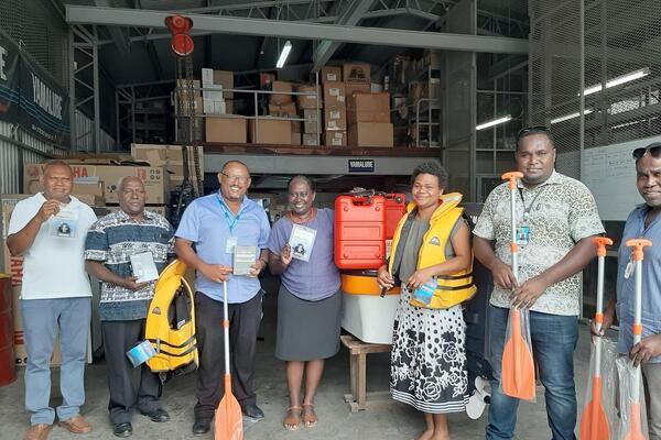 Dr Zelalem Taffesse of UNICEF with the Permanent Secretary of the Ministry of Health and Medical Services Ms Pauline McNeil and her staff during the handover.