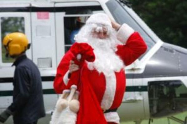 Santa adjusts his hat after a landing practice for next week's 'Carols in the Islands', to be held at Lawson Tama Stadium on Saturday 12 December.