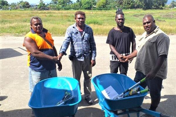Two Noni Farmers receive support from GP extension staff.