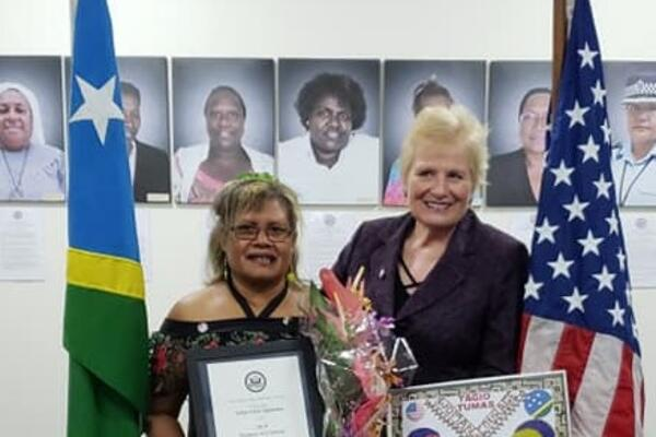 Ambassador Gray with Mrs Sigimanu at the award ceremony.