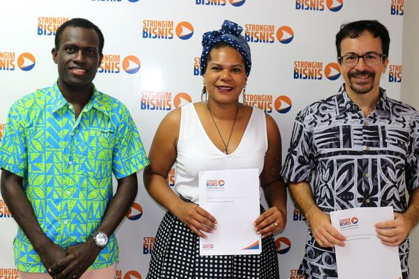 L - R: The Young Entrepreneurs Council Solomon Islands (YECSI) Coordinator, Emmanuel Pitakaka, Chairlady, Millicent Barty, Women's Economic Empowerment and Youth Director at Strongim Bisnis, Mr Gianluca Nardi and after signing the partnership agreement to pursue the Youth Innovation Programme.