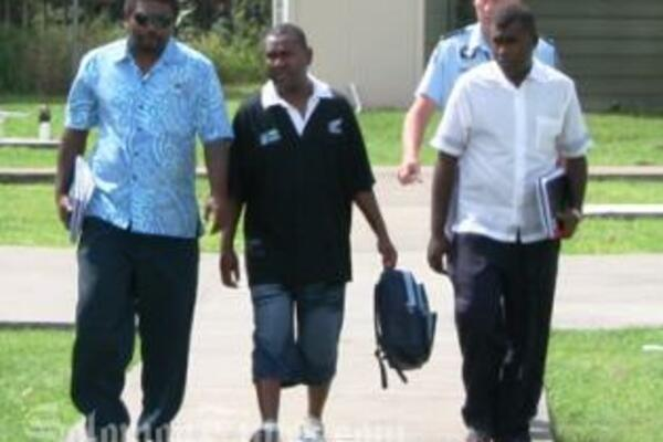 Philip Bobongi (centre) is escorted by officers from the RSIPF's Corruption Squad to appear before Honiara Magistrate's Court for alleged money laundering offences.